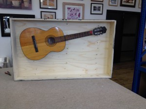 Bespoke Box framing a Guitar
